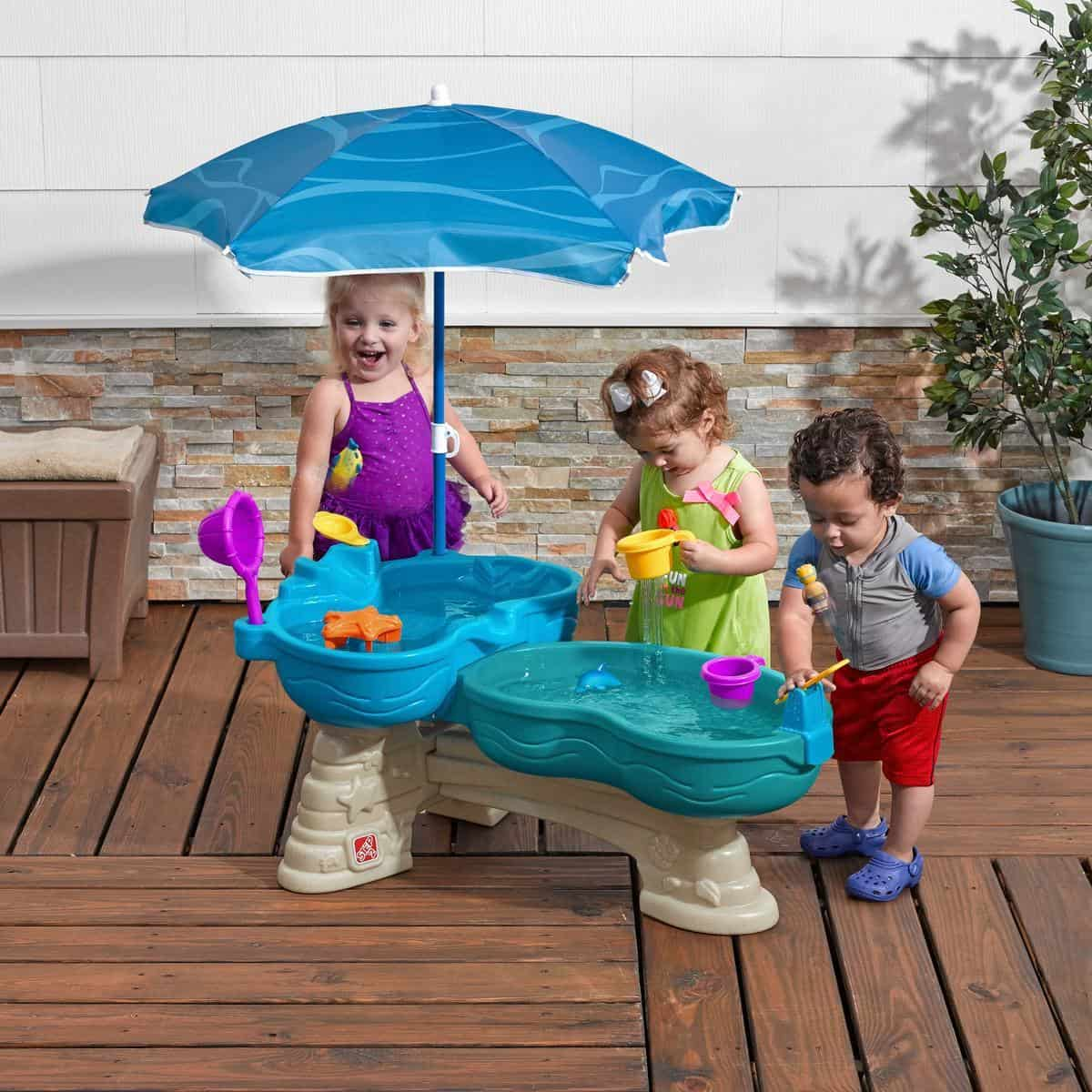 Kids playing spill and splash seaway water table.