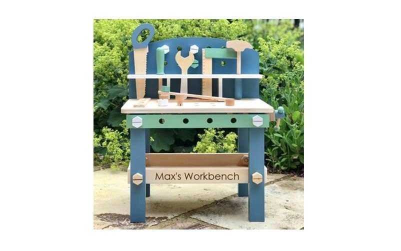 Lovely personalised wooden workbench with soft or pastel color.