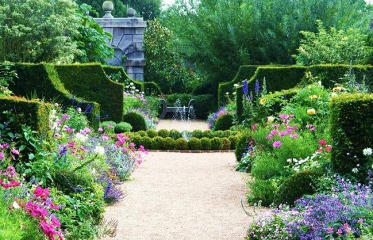 A symmetrical view of the hedges and flowers in one of the Arundel Castle gardens.