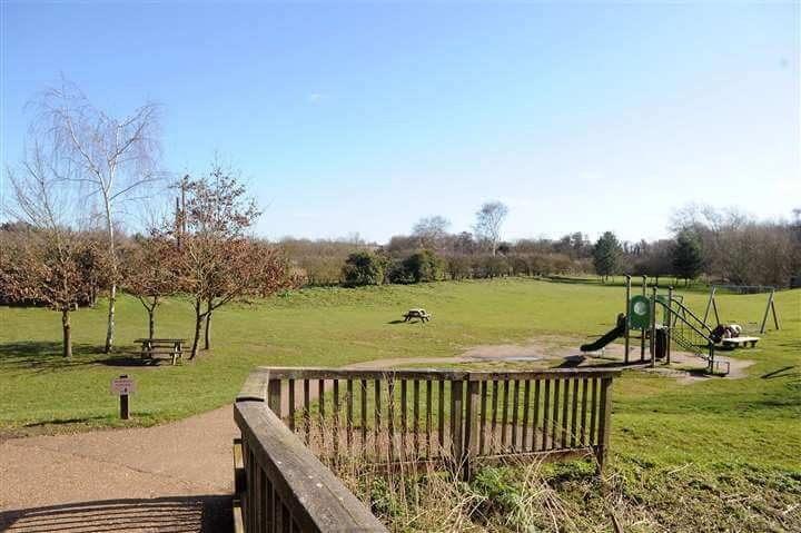 Play area and green field at Needham Lake and Nature Reserve.