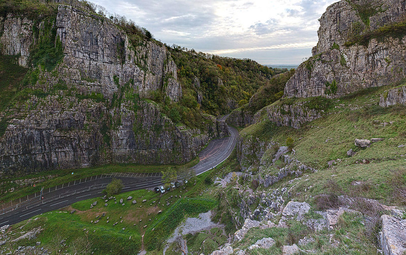 View of the steep road running through the green hills of Cheddar Gorge.