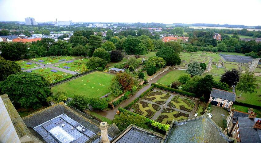View from the Abbey of the Abbey Gardens and green lawns.