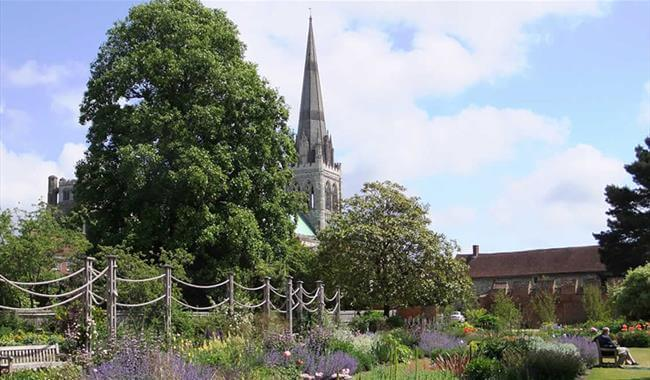The spire of Chichester Cathedral from the gardens.