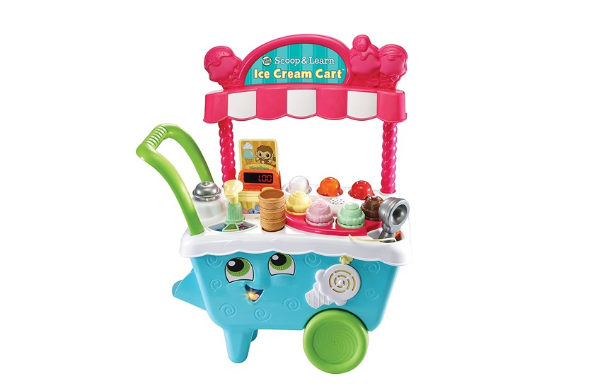 Cute and fabulous pink ice cream cart with different colorful scoop toys.