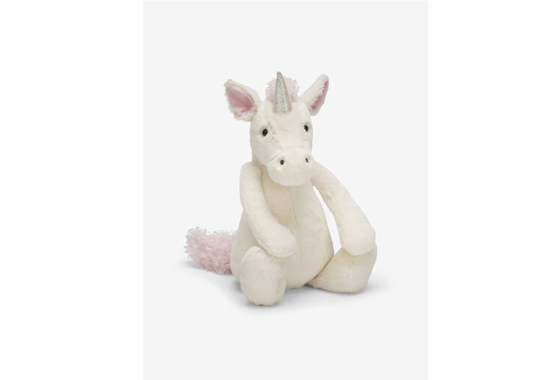 Sitting white soft and fluffy unicorn.