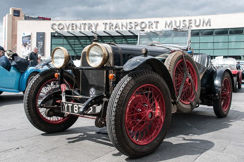 An old fashioned car outside Coventry Transport Museum.