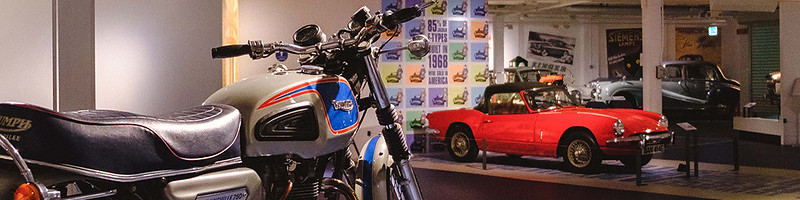 Old fashioned cars and motorbikes on display at Coventry Transport Museum.