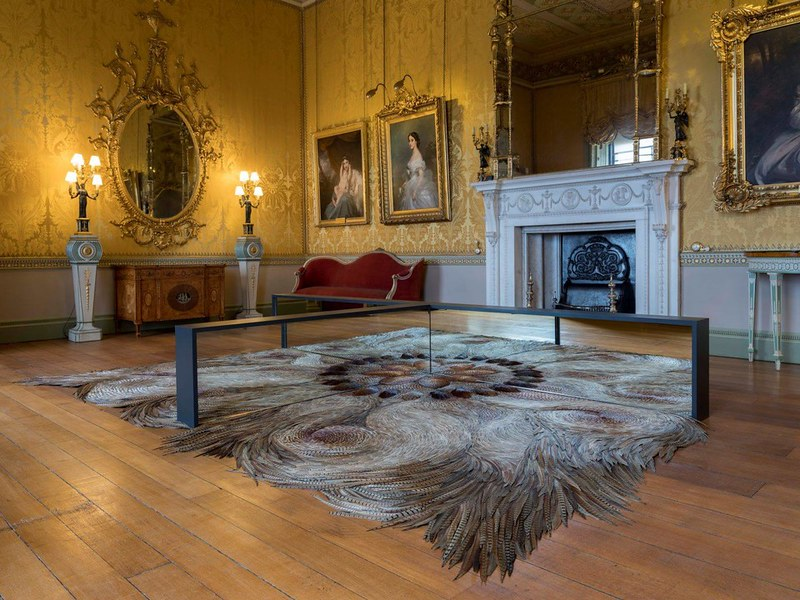 Harewood House decadent interior with fireplace and decour.