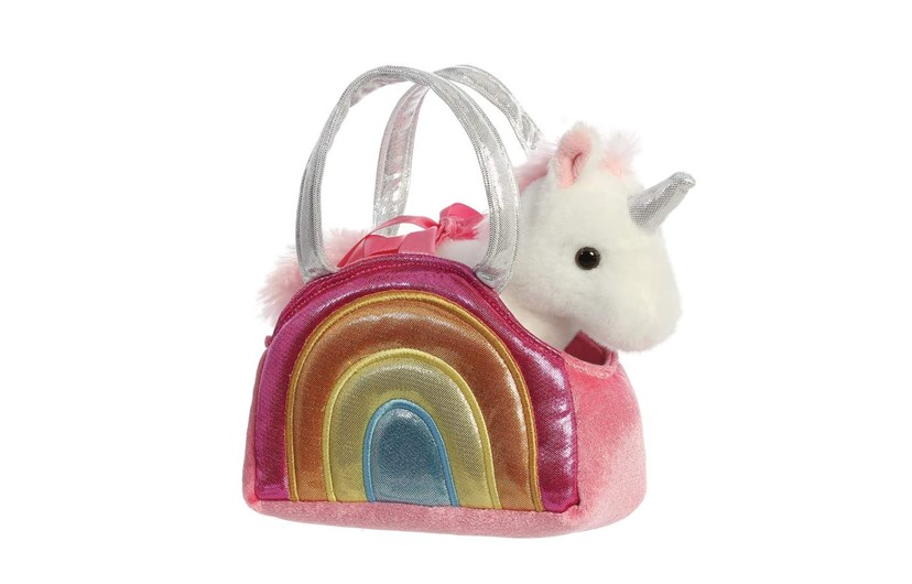 Beautiful fluffy unicorn in the pink and rainbow handbag.