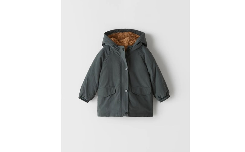 Anthracite grey parka hooded coat with two pockets, and button zipper lock.