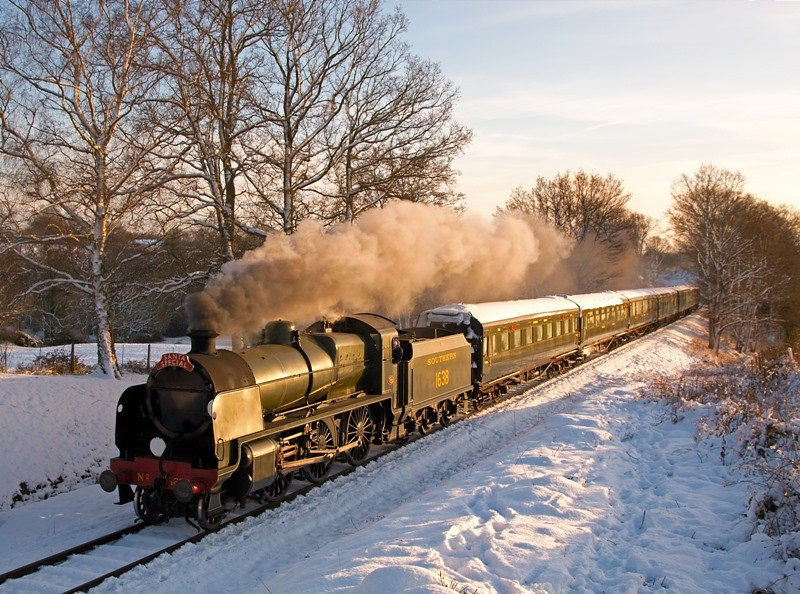 Bluebell Railway in winter surrounded by snow.