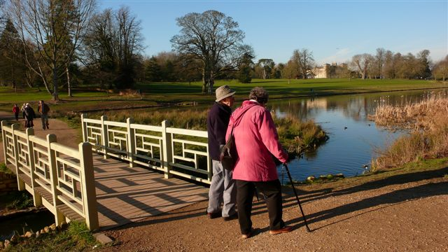 Families walk around Lydiard Park.