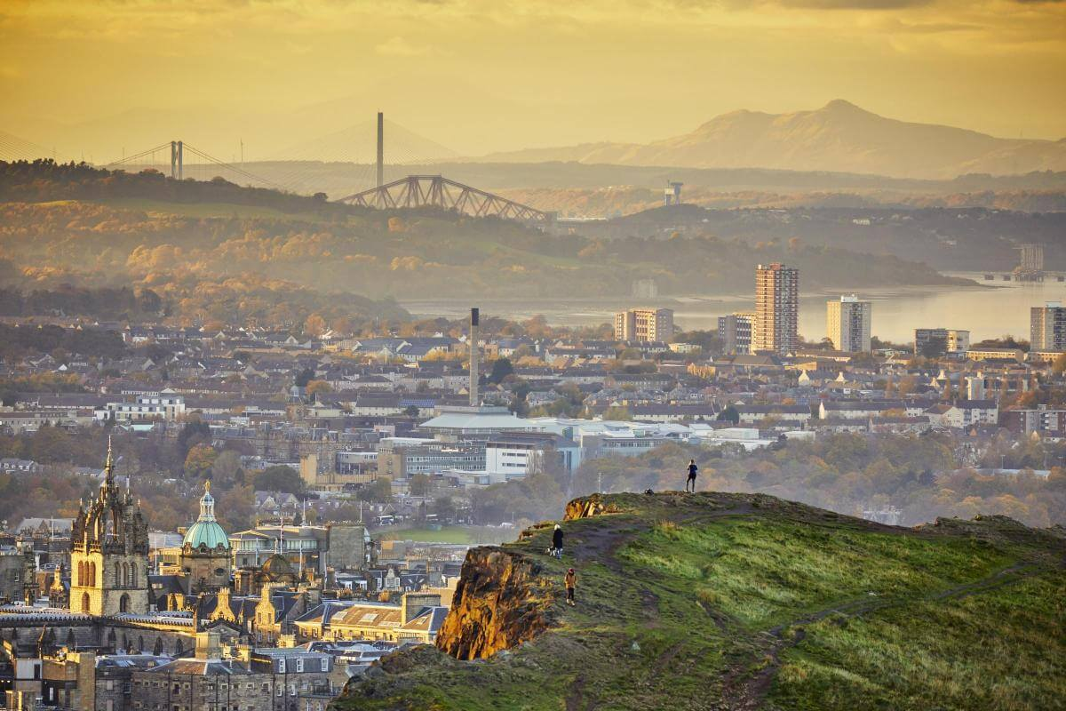 A view from the top of Arthur's Seat, of the foggy landscape showing Edinburgh and beyond.