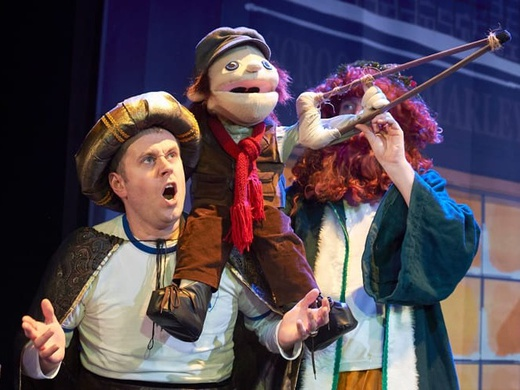 The comedy duo Dan and Jeff with a puppet sitting on one of their shoulders in the show Potted Panto.