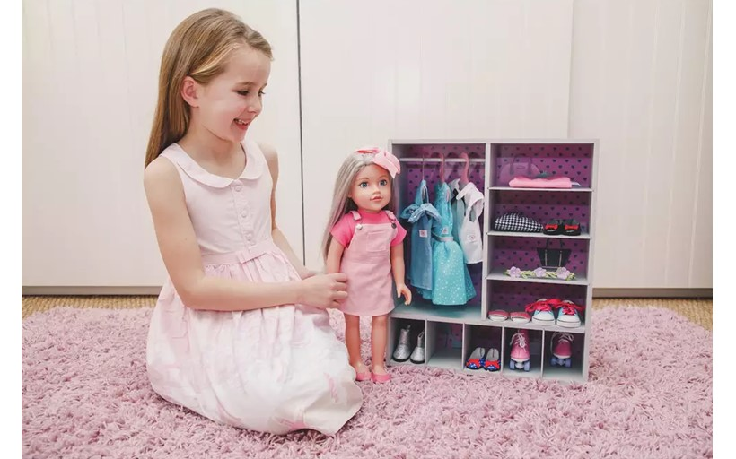 Cute mini doll closet with black polka dots design with several compartments for different doll's outfit.