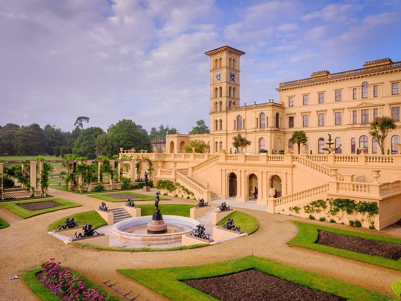 The Italian palazzo style architecture of Osborne House, surrounded by formal gardens.