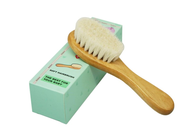 Hypoallergenic wooden with soft bristles brush made of goat's hair perfect  for baby's hair grooming.
