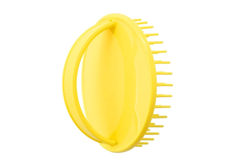 Cute yellow brush used for baby's bathing time.