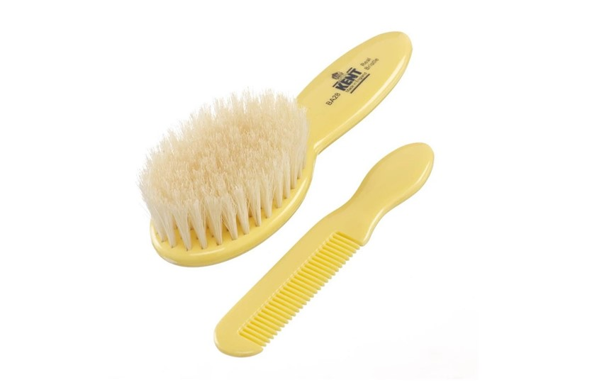 Set of cute baby's hair brush and comb with soft pure white bristle.