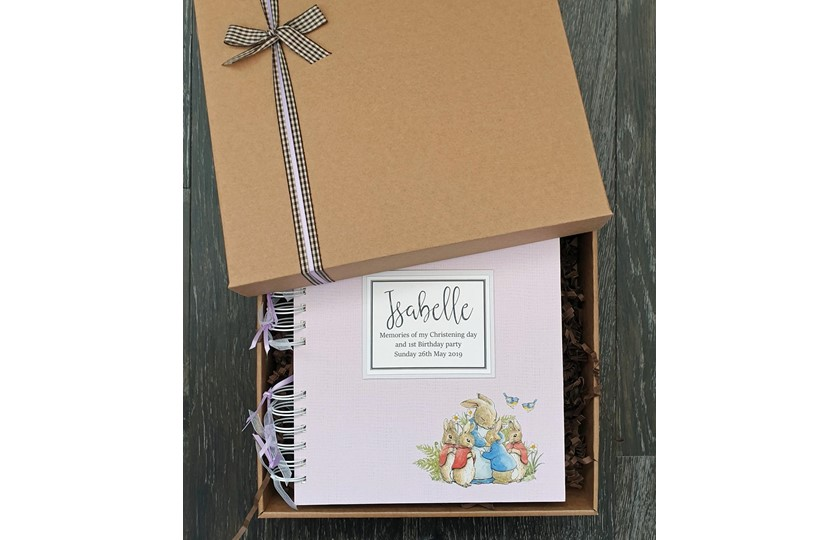 Excellent beautiful package of keepsake with scrapbook and bow perfect for memories storage.
