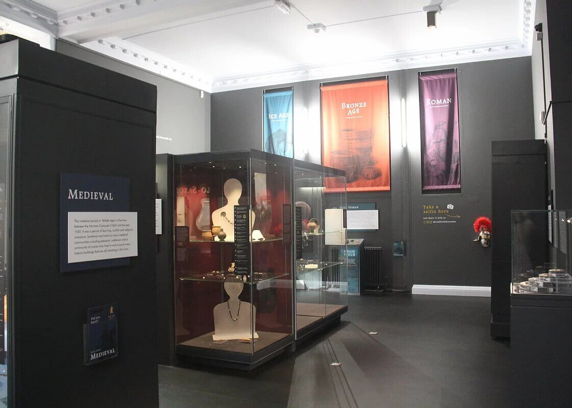 The interior of the museum at Southend Planetarium, with exhibits in glass cabinets.