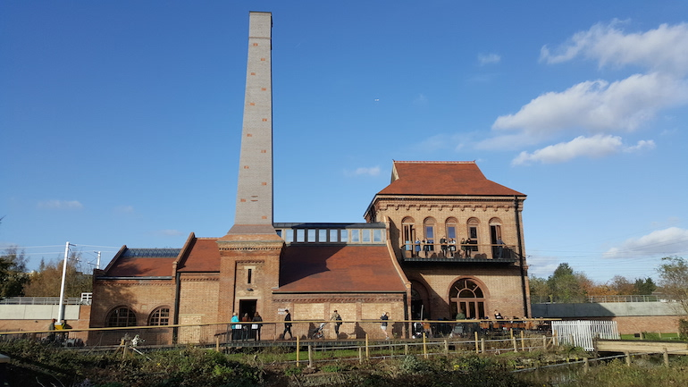The Engine House at Walthamstow Wetlands against a blue sky.