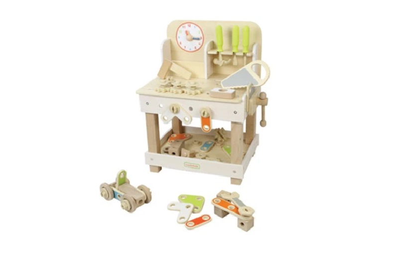 Cute soft colors wooden workbench with tools for kids.