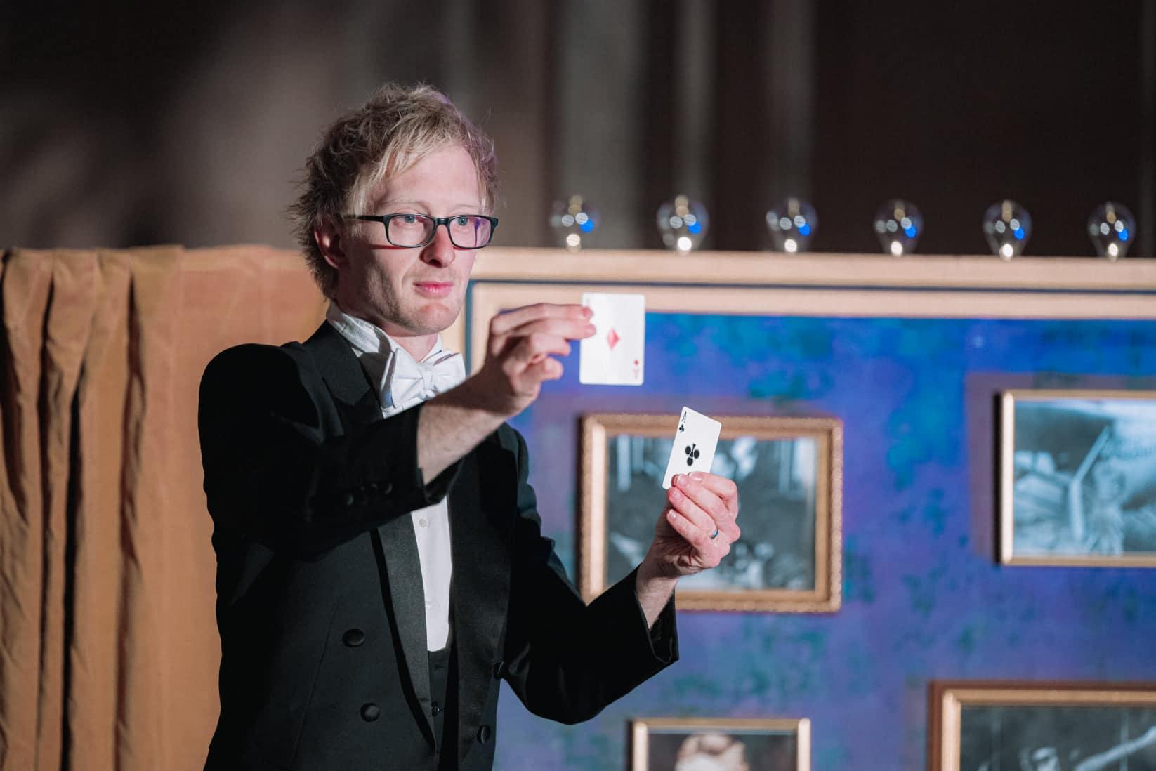 A magician doing a card trick in a magic show.