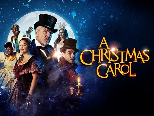 The cast of A Christmas Carol standing in front of a full moon in the promotional poster.