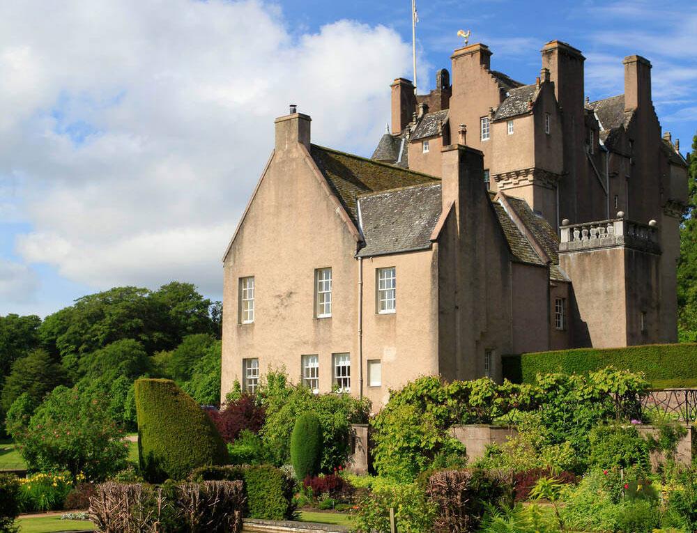 The exterior of Crathes Castle Garden against a blue sky.