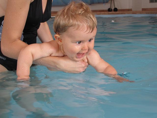 Adventurous babies love to go swimming.