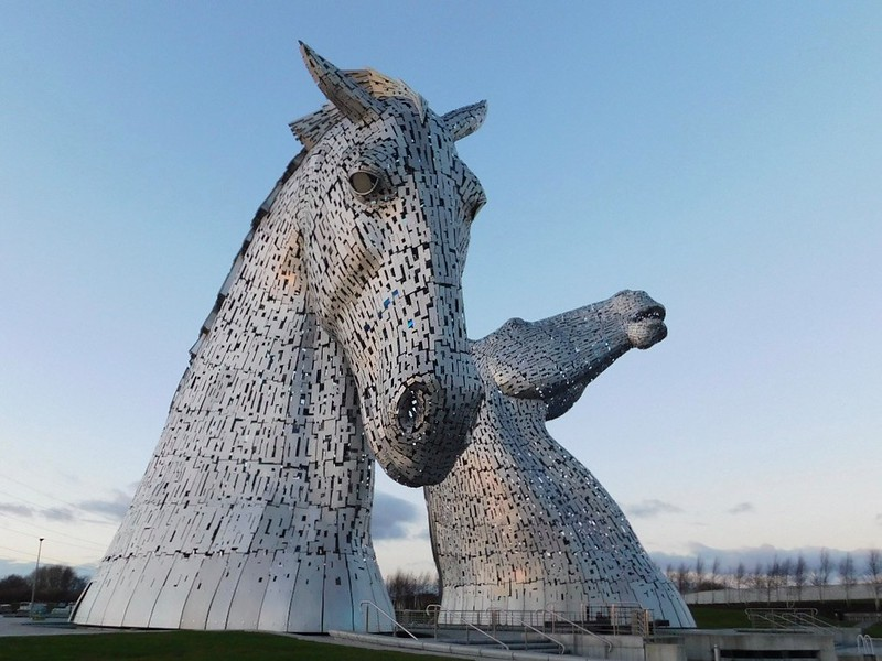 The large silver horse head figures of The Kelpies (and The Helix).