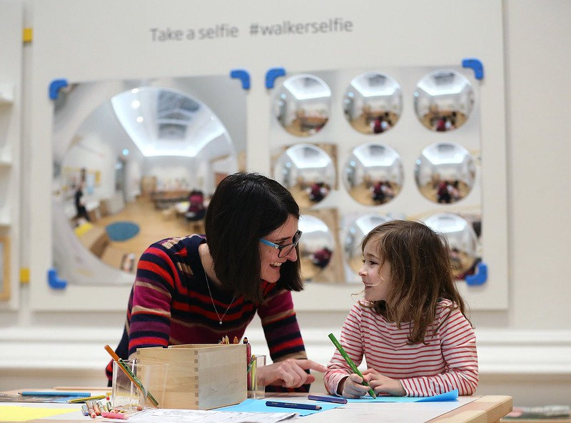 A woman and child learning and making crafts at the Walker Art Gallery.