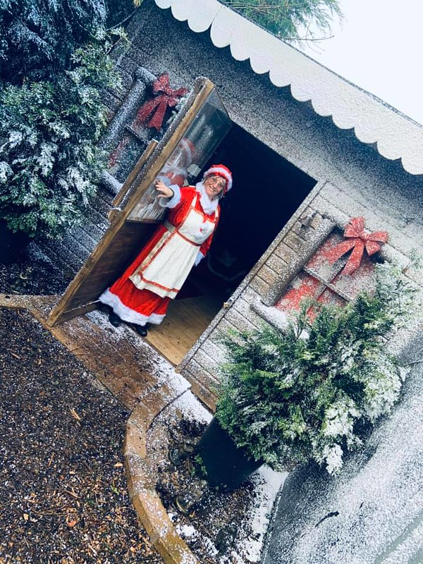 Mrs Claus opening the door of Santa's Grotto at Greenacres Animal Park.