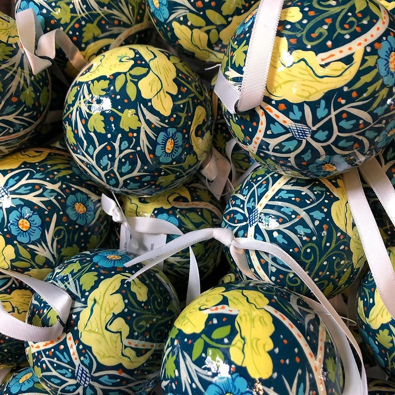 A close up of baubles on sale at the William Morris Gallery shop with a blue and green design.