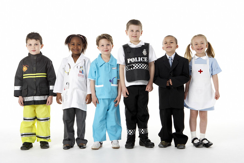 Kids dressing up in work costumes, in police outfit.