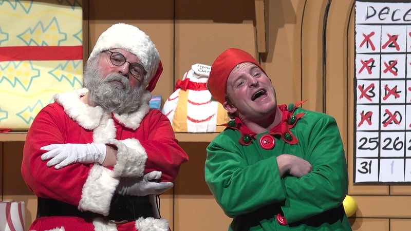 Santa and an elf on stage in the show Dear Santa.