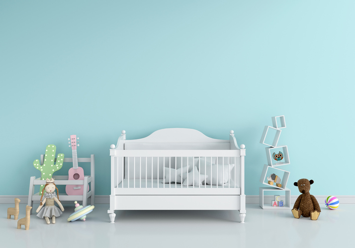 Doll cot in bedroom with toys.