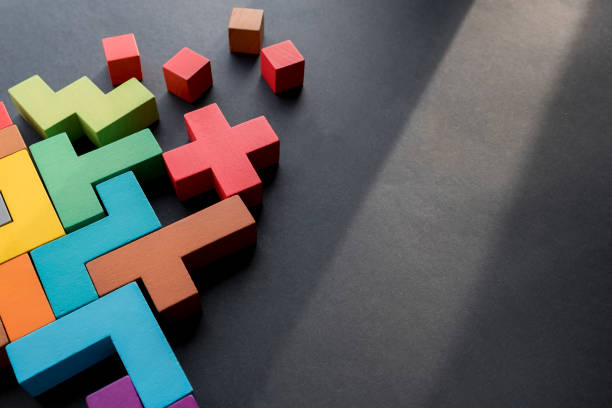 Colored tetris blocks intertwined against a gray background