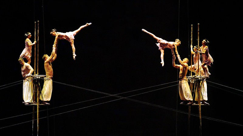 Acrobats performing a jumping stunt in the Cirque du Soleil show.