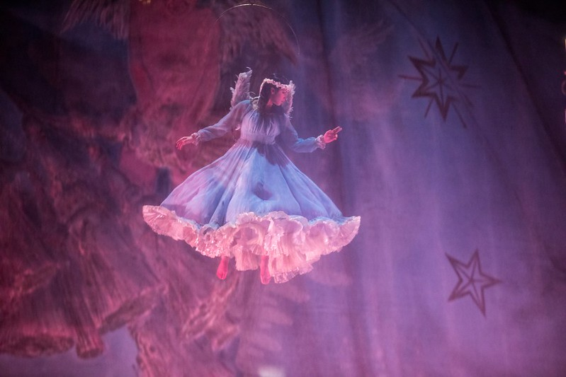 An actress in the Cirque du Soleil show dressed as an angel suspended from the ceiling.