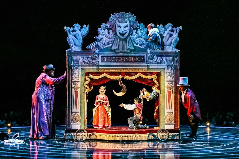 A tiny intimate theatre on stage in the Cirque du Soleil show.