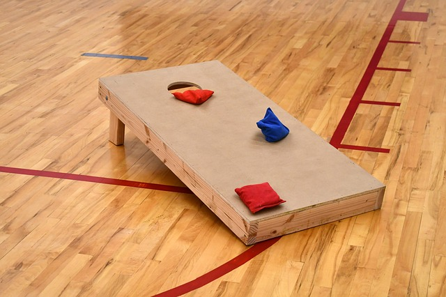 The cornhole game is a one-on-one game, where both team members throw the bags of corn in a hole game.