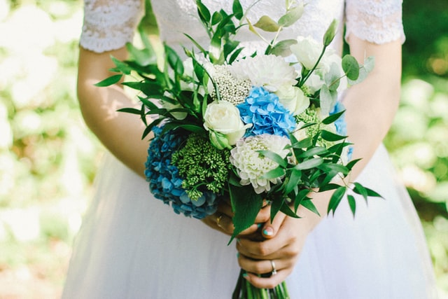 We love blue and white flowers in a wedding bouquet.
