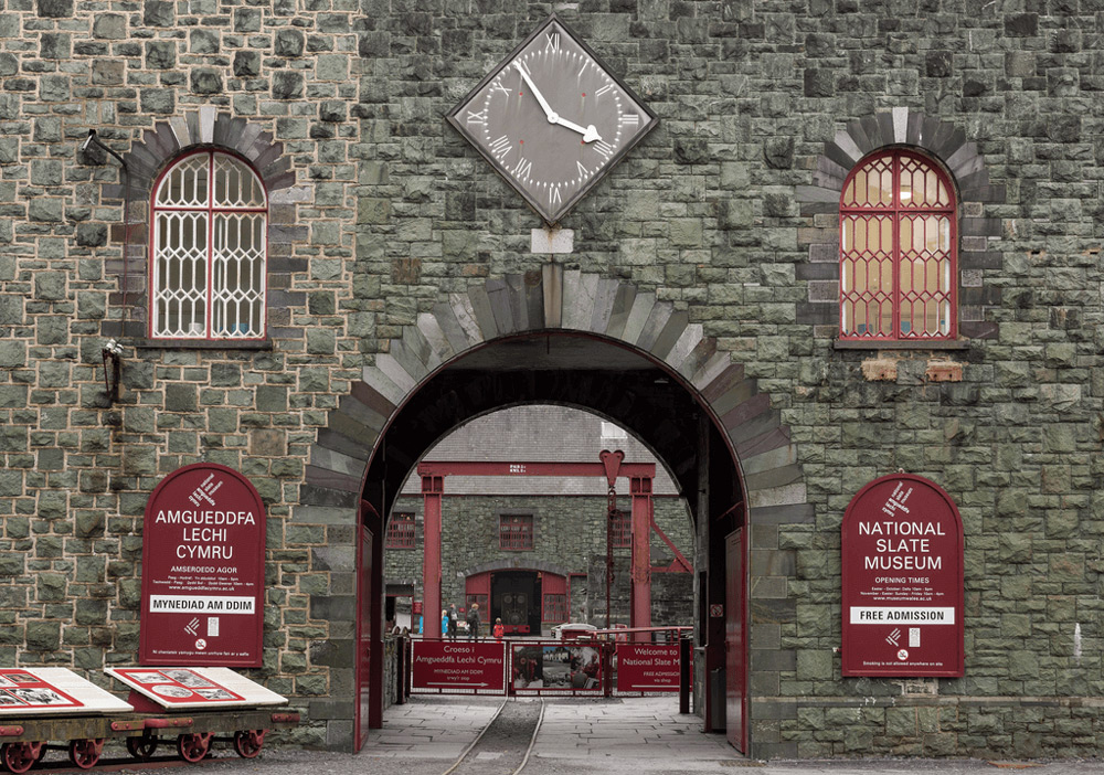 The stone archway and old clock outside the National Slate Museum.
