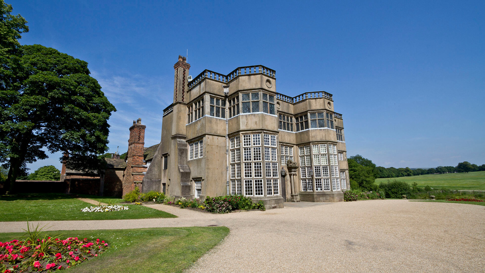 View of Astley Hall from outside with a blue sky background.