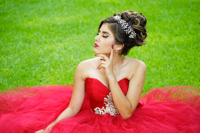 Girls wear ball gowns for their special day.