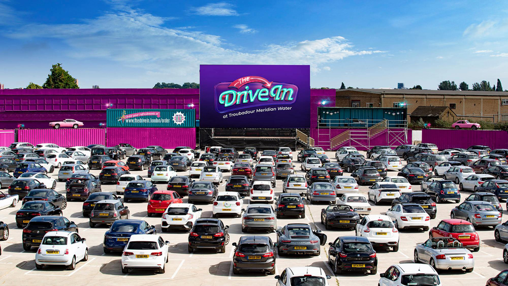 Rows of cars parked up ready to watch a film at The Drive In.