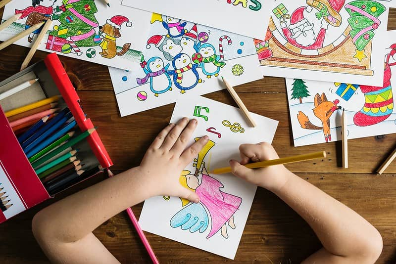 Child making one of the nine types of family Christmas card.