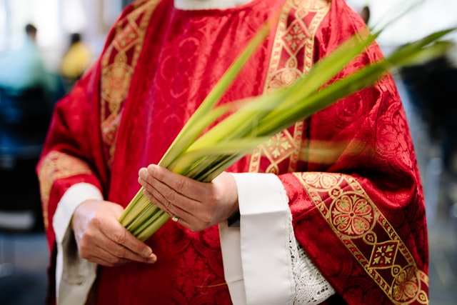 Red vestements are worn on Palm Sunday.